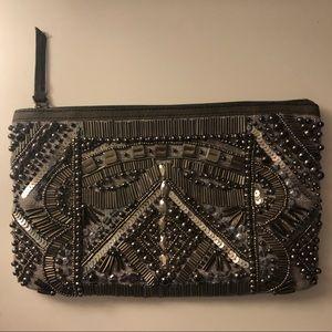 Anthropologie metallic clutch purse